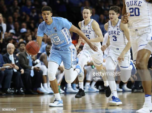 Cameron Johnson of the North Carolina Tar Heels drives against the Duke Blue Devils during the semifinals of the ACC Men's Basketball Tournament at...