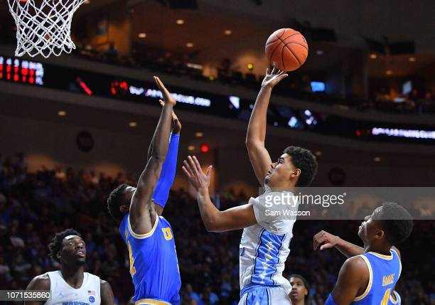 Cameron Johnson of the North Carolina Tar Heels shoots against David Singleton of the UCLA Bruins during the 2018 Continental Tire Las Vegas...