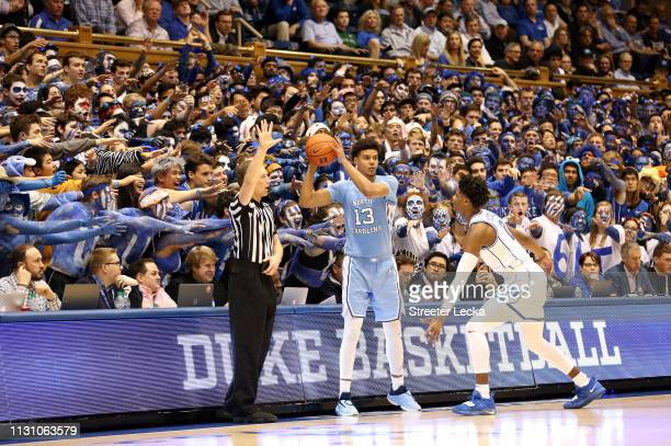 Cameron Johnson of the North Carolina Tar Heels tries to throw the ball in bounds against Cam Reddish of the Duke Blue Devils during their game at...