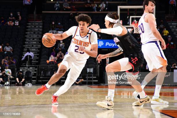 Cameron Johnson of the Phoenix Suns dribbles the ball during the game against the Houston Rockets on April 12, 2021 at Phoenix Suns Arena in Phoenix,...