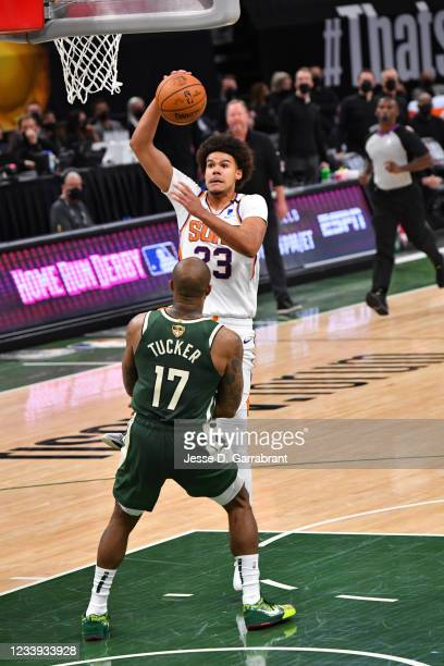 Cameron Johnson of the Phoenix Suns dunks the ball against P.J. Tucker of the Milwaukee Bucks during Game Three of the 2021 NBA Finals on July 11,...