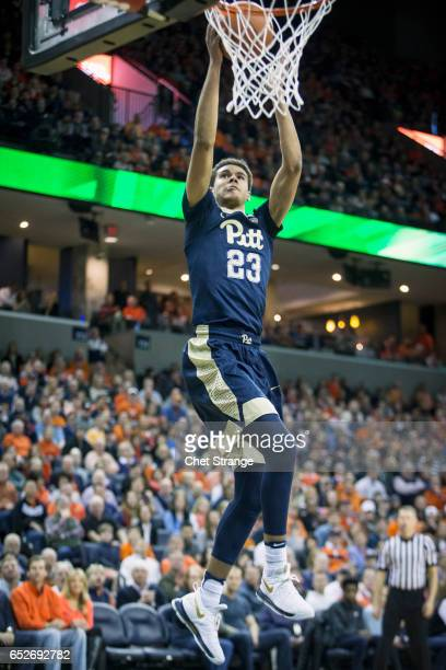 Cameron Johnson of the Pittsburgh Panthers dunks the ball during Pittsburgh's game against the Virginia Cavaliers at John Paul Jones Arena on March 4...