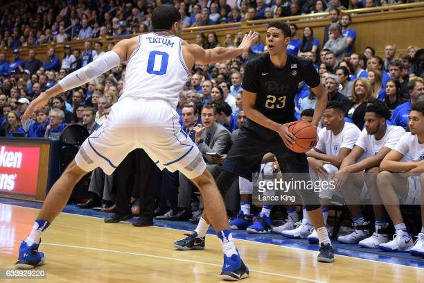 Cameron Johnson of the Pittsburgh Panthers in action against Jayson Tatum of the Duke Blue Devils at Cameron Indoor Stadium on February 4 2017 in...