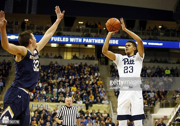 Cameron Johnson of the Pittsburgh Panthers pulls up for three against Steve Vasturia of the Notre Dame Fighting Irish at Petersen Events Center on...