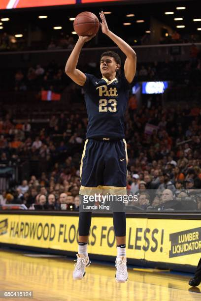 Cameron Johnson of the Pittsburgh Panthers puts up a shot against the Virginia Cavaliers during the second round of the ACC Basketball Tournament at...