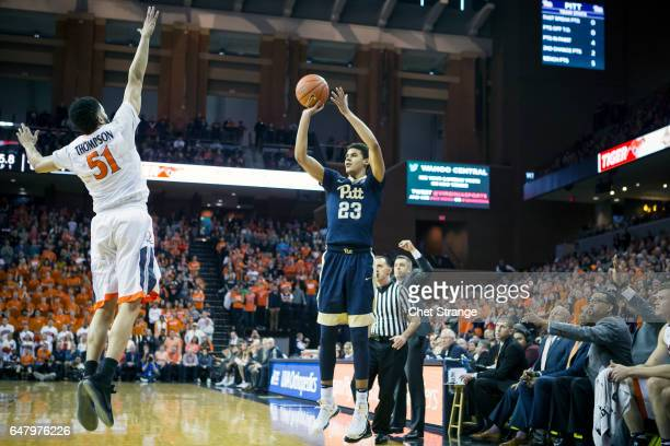 Cameron Johnson of the Pittsburgh Panthers shoots the ball over Darius Thompson of the Virginia Cavaliers during a game at John Paul Jones Arena on...