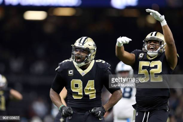 Cameron Jordan and Craig Robertson of the New Orleans Saints gesture to fans against the Carolina Panthers during the second half of the NFC Wild...