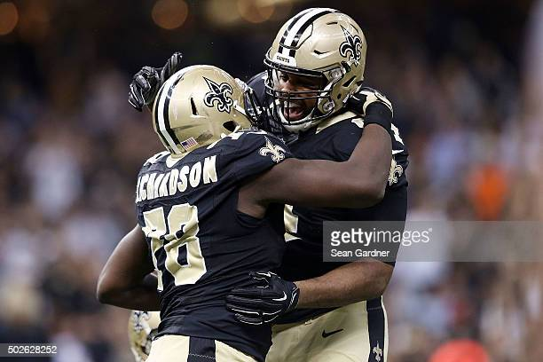 Cameron Jordan celebrates with Bobby Richardson of the New Orleans Saints following an interception against the Jacksonville Jaguars at the...