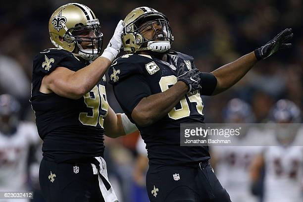 Cameron Jordan of the New Orleans Saints celebrates a sack with Paul Kruger during the first half of a game against the Denver Broncos at the...