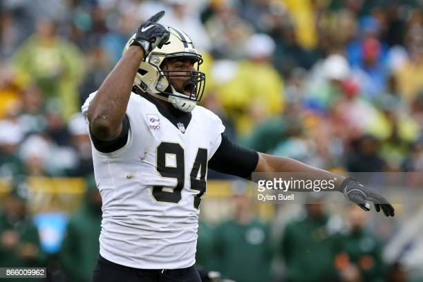 Cameron Jordan of the New Orleans Saints celebrates after recording a sack in the third quarter against the Green Bay Packers at Lambeau Field on...
