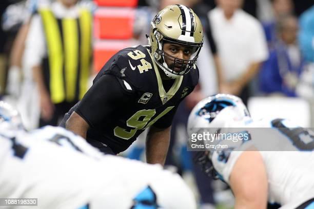 Cameron Jordan of the New Orleans Saints defends during the first half against the Carolina Panthers at the MercedesBenz Superdome on December 30...