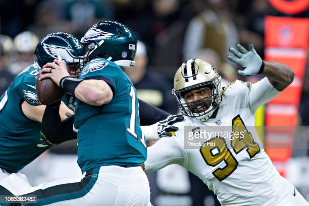 Cameron Jordan of the New Orleans Saints puts pressure on quarterback Carson Wentz of the Philadelphia Eagles in the second half of a game at...