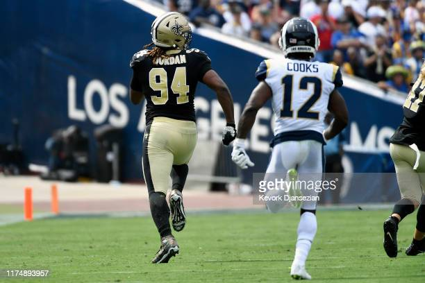 Cameron Jordan of the New Orleans Saints returns a fumble for a touchdown that was nullified due to the play being called an incomplete pass by the...