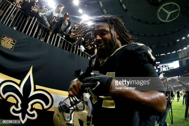Cameron Jordan of the New Orleans Saints runs off the field after his team defeated the Carolina Panthers during the NFC Wild Card playoff game at...