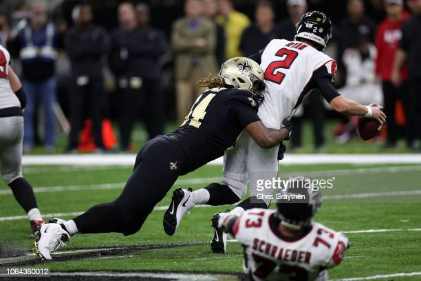 Cameron Jordan of the New Orleans Saints sacks Matt Ryan of the Atlanta Falcons at the MercedesBenz Superdome on November 22 2018 in New Orleans...