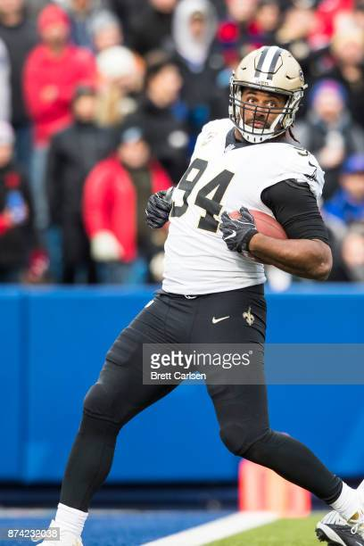 Cameron Jordan of the New Orleans Saints sarcastically carries a blocked pass into the end zone during the third quarter against the Buffalo Bills at...