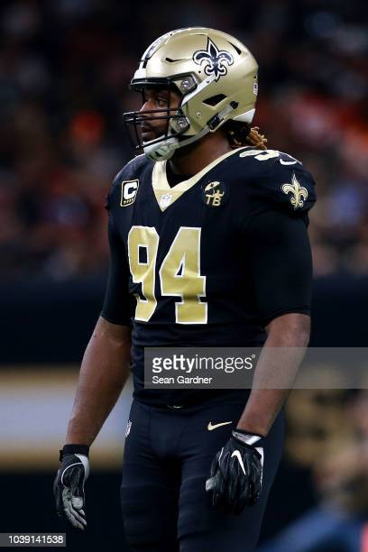 Cameron Jordan of the New Orleans Saints stands on the field during a game against the Cleveland Browns at MercedesBenz Superdome on September 16...