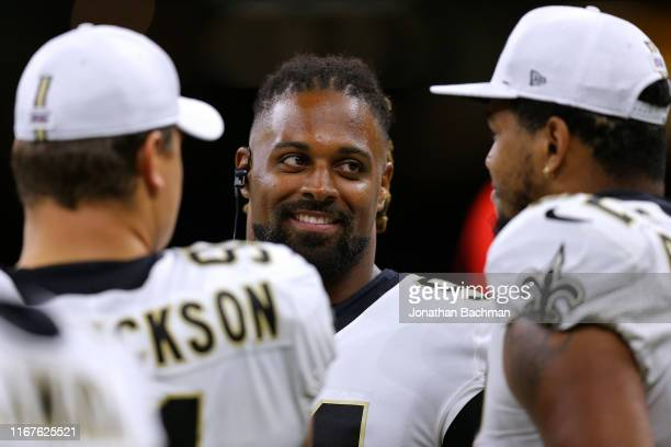 Cameron Jordan of the New Orleans Saints talks to Marcus Davenport and Trey Hendrickson during a preseason game at the Mercedes Benz Superdome on...