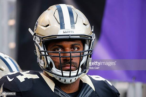Cameron Jordan of the New Orleans Saints waits to take the field before the start of a preseason game against the Baltimore Ravens at MT Bank Stadium...