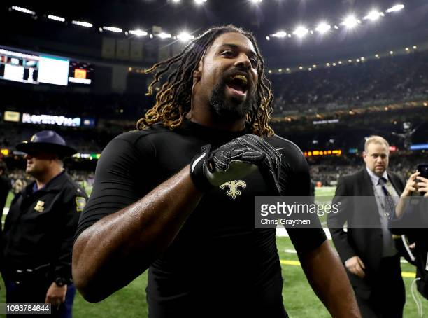 Cameron Jordan of the New Orleans Saints walks off the field after his teams win over the Philadelphia Eagles in the NFC Divisional Playoff Game at...