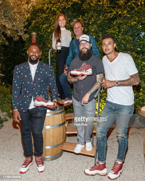 Cameron Jordan Rebecca Grant John Jordan Troy Cole and Kyle Kuzma pose for a photo at the 2015 Jordan Cabernet Release Day Party on May 01 2019 in...