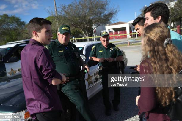 Cameron Kasky jr and other students of Marjory Stoneman Douglas High School speak with Broward County Sheriff officers Brad Griesinger and Jamie...