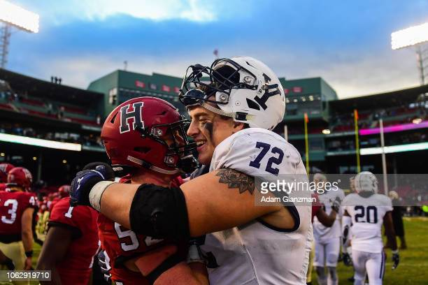 Cameron Kline of the Harvard Crimson embraces Dieter Eiselen of the Yale Bulldogs after a Harvard Crimson victory at Fenway Park on November 17 2018...