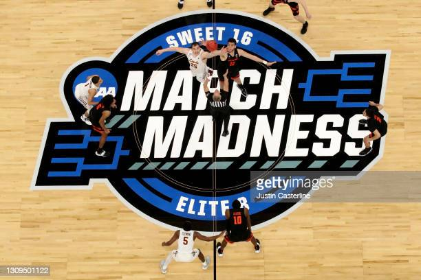 Cameron Krutwig of the Loyola-Chicago Ramblers and Roman Silva of the Oregon State Beavers jump for the opening tip off in the Sweet Sixteen round of...
