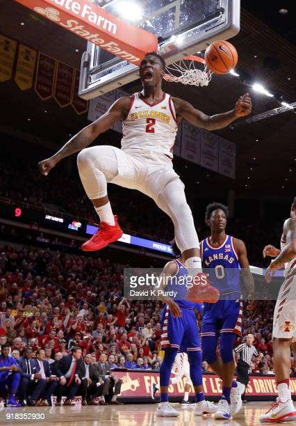 Cameron Lard of the Iowa State Cyclones celebrates after dunking the ball as Marcus Garrett of the Kansas Jayhawks watches on in the first half of...