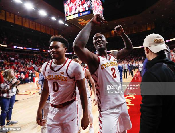 Cameron Lard of the Iowa State Cyclones celebrates with teammate Zion Griffin of the Iowa State Cyclones after defeating the Texas Longhorns 65-60 at...