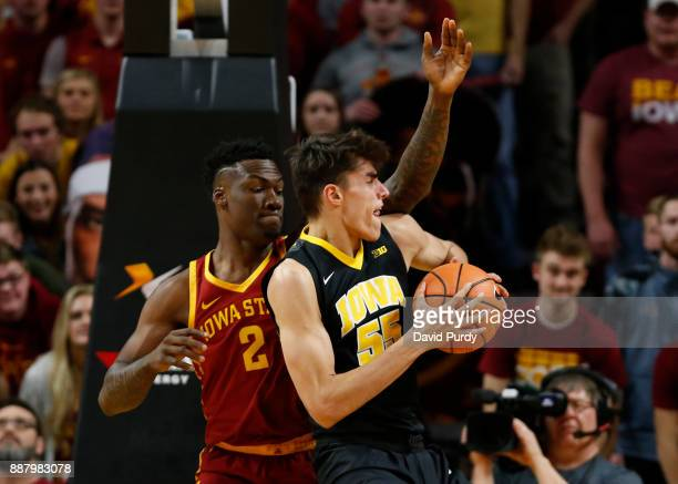 Cameron Lard of the Iowa State Cyclones defends as Luka Garza of the Iowa Hawkeyes drives the ball to the basket in the first half of play at Hilton...
