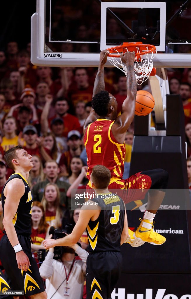 Cameron Lard #2 of the Iowa State Cyclones dunks the ball as Jack Nunge #2 of the Iowa Hawkeyes, and Jordan Bohannon #3 of the Iowa Hawkeyes watch on in the second half of play at Hilton Coliseum on December 7, 2017 in Ames, Iowa. The Iowa State Cyclones won 84-78 over the Iowa Hawkeyes.