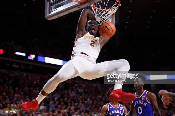 Cameron Lard of the Iowa State Cyclones dunks the ball as Marcus Garrett of the Kansas Jayhawks watches on in the first half of play at Hilton...