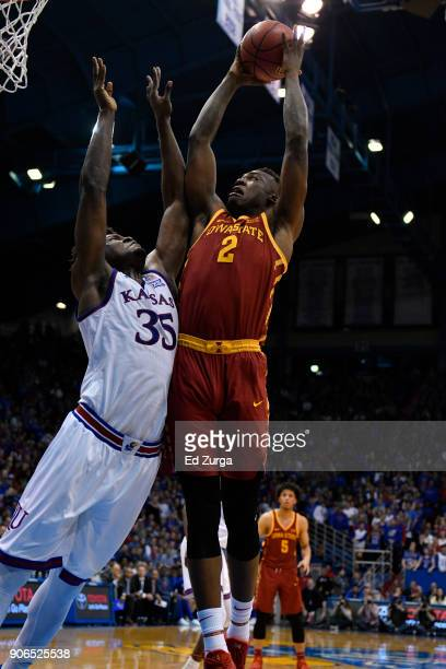 Cameron Lard of the Iowa State Cyclones shoots against Udoka Azubuike of the Kansas Jayhawks at Allen Fieldhouse on January 9 2018 in Lawrence Kansas