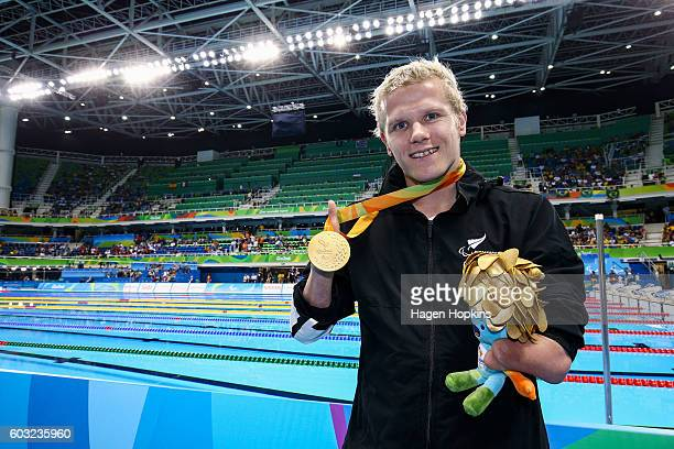 Cameron Leslie of New Zealand poses with his gold medal after winning the Men's 150m Individual Medley SM4 final in a world record time of 22312 on...