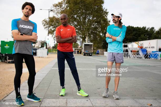 Cameron Levins of Canada Abdi Abdirahman of the United States and Noah Droddy of the United States take part in a shakeout run with runners taking...