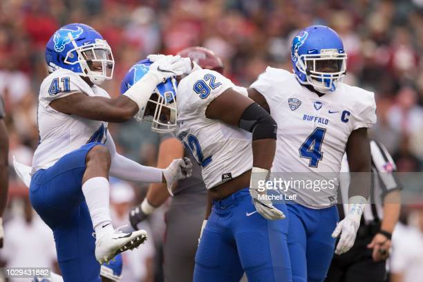 Cameron Lewis Chuck Harris and Khalil Hodge of the Buffalo Bulls react in the first quarter against the Temple Owls at Lincoln Financial Field on...