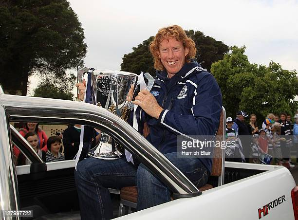 Cameron Ling holds the premiership cup during the Geelong Cats AFL Grand Final celebration street parade on October 5, 2011 in Geelong, Australia.