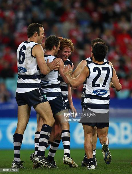 Cameron Ling of the Cats celebrates after kicking a goal during the round 18 AFL match between the Sydney Swans and the Geelong Cats at ANZ Stadium...