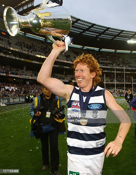 Cameron Ling of the Cats celebrates with the Premiership Cup after winning the 2011 AFL Grand Final match between the Collingwood Magpies and the...