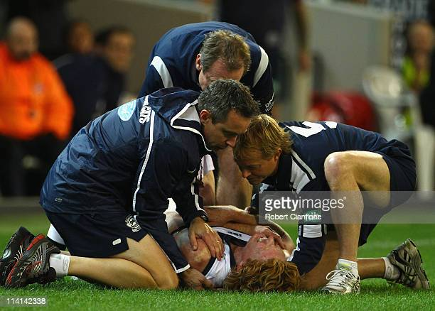 Cameron Ling of the Cats is checked by medical staff for an injury during the round eight AFL match between the Geelong Cats and the Collingwood...