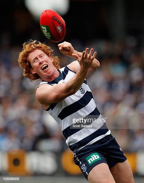 Cameron Ling of the Cats passes the ball during the round 17 AFL match between the Geelong Cats and the Brisbane Lions at Skilled Stadium on July 24,...