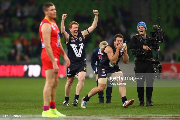 Cameron Ling of Victoria and Campbell Brown of Victoria react after Matthew Richardson of the All-Stars misses a goal during the over-time kick off...