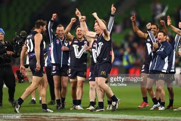 Cameron Ling of Victoria and team mates celebrate Jarrad Waite of Victoria's goal during overtime during the EJ Whitten Legends Match at AAMI Park on...
