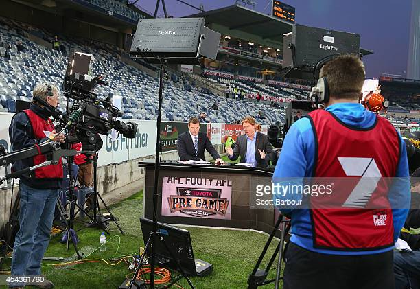 Cameron Ling speaks to camera as Channel 7 film their pre-game show before the round 23 AFL match between the Geelong Cats and the Brisbane Lions at...