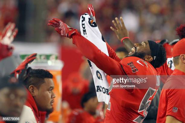 Cameron Lynch of the Bucs signals the fourth quarter at the start of the fourth quarter during the NFL Regular game between the New England Patriots...