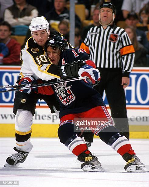 Cameron Mann of the Boston Bruins collides with Theo Fleury of the New York Rangers in game at the Fleet Center in Boston