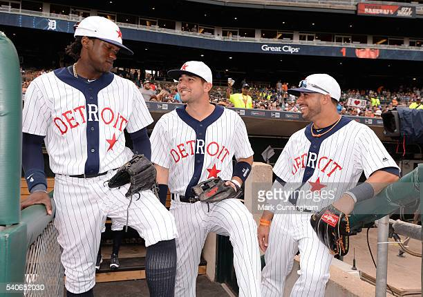 Cameron Maybin Nick Castellanos and Mike Aviles of the Detroit Tigers stand together on the dugout stairs while wearing Detroit Stars Negro League...