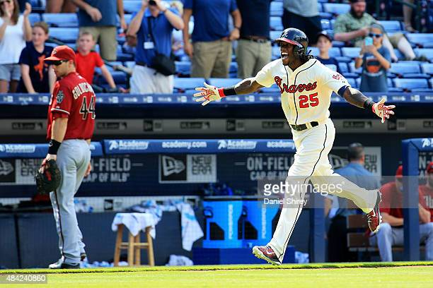Cameron Maybin of the Atlanta Braves celebrates a walk off home run in the tenth inning against the Arizona Diamondbacks at Turner Field on August 16...