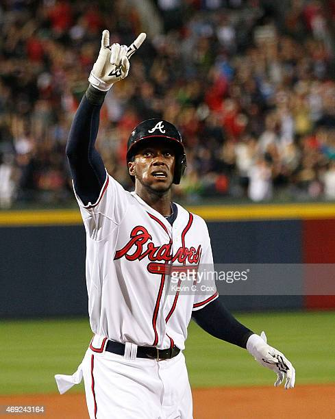 Cameron Maybin of the Atlanta Braves celebrates just before crossing homeplate after hitting a solo homer in the first inning against the New York...